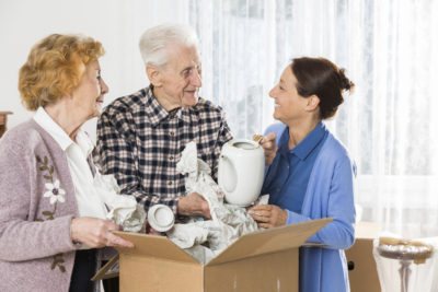 Elderly Couple Packing Moving